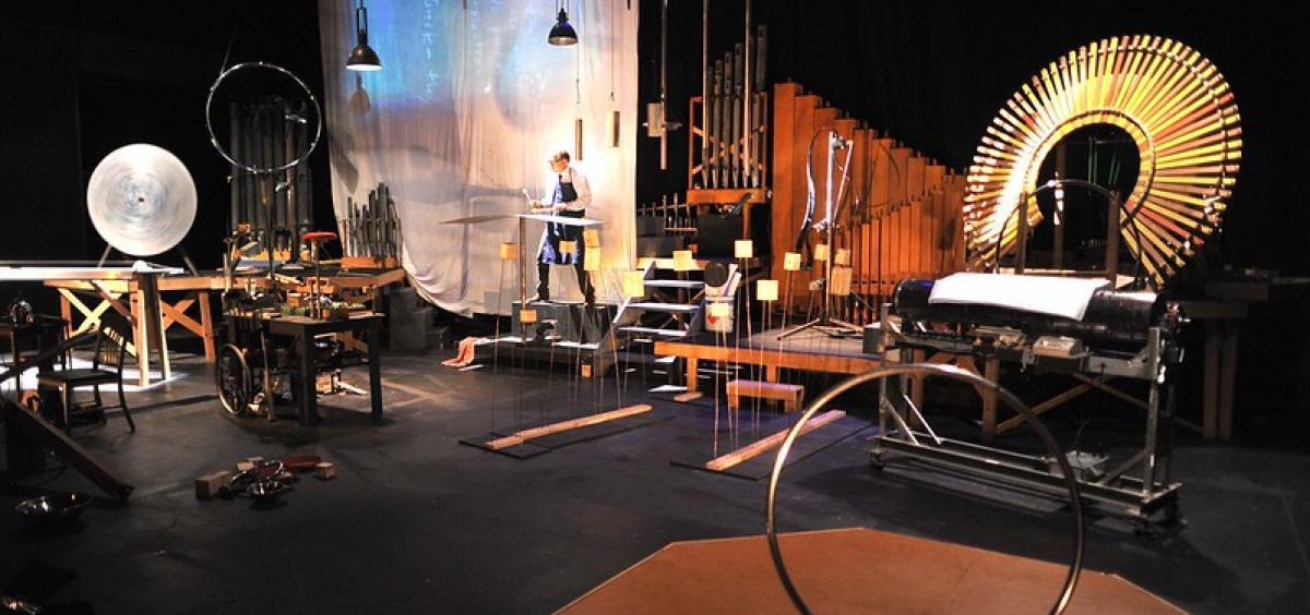 Wide shot of Schick Machine onstage with instruments