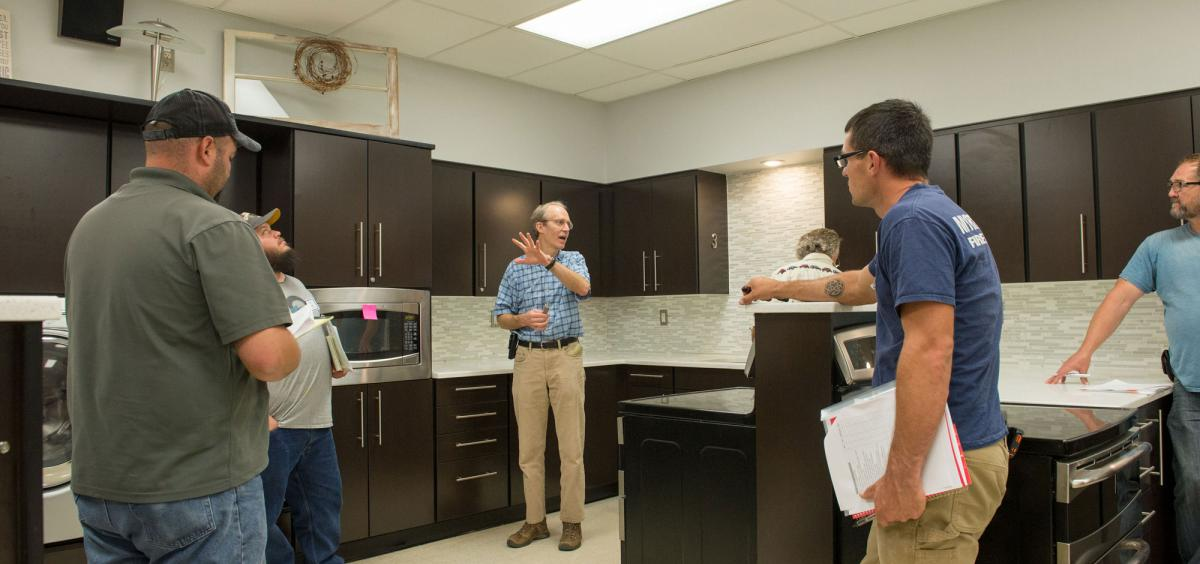 Tim Stock (center), coordinator of the Oregon State University School IPM Program, conducts training at West Albany High School in 2017