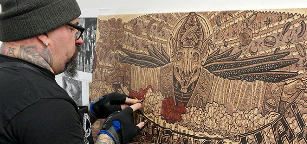 Printmaking artist Tom Huck at work