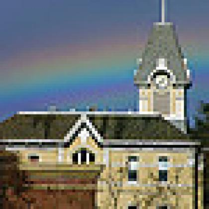University building with rainbow behind