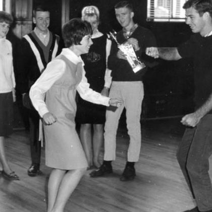 dance contestants Marsha Fowler '68 and Jim Martin '66. Standing in back are Dianne Conn, Mike Aldrich, Gail Boersma and Dick Alexander.