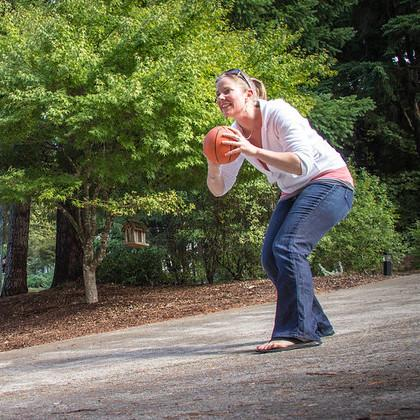 Parent holds a ball to pass to child