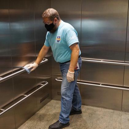 man cleaning elevator