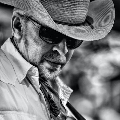 Black & white publicity photo of Dave Alvin