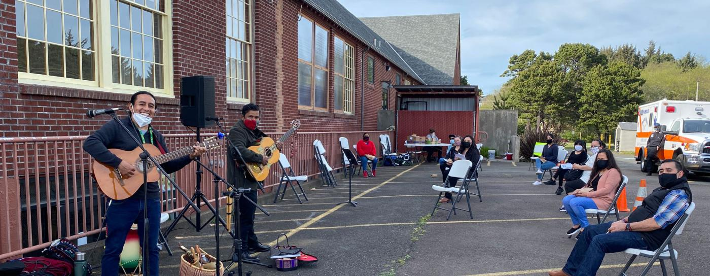 A band plays at a vaccine clinic in Lincoln City that was hosted by the Olalla Center for Latinx and Indigenous community members. OSU students and Extension employees were on hand to support the clinic.